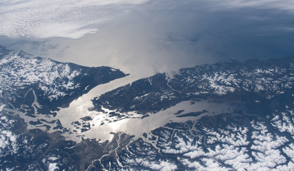 March 11, 2020) --- The Strait of Juan de Fuca and the Salish Sea, pictured from the International Space Station, separate the western-most border of the United States and Canada.